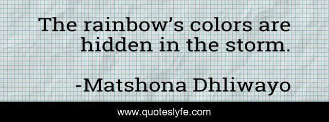 The rainbow's colors are hidden in the storm.
